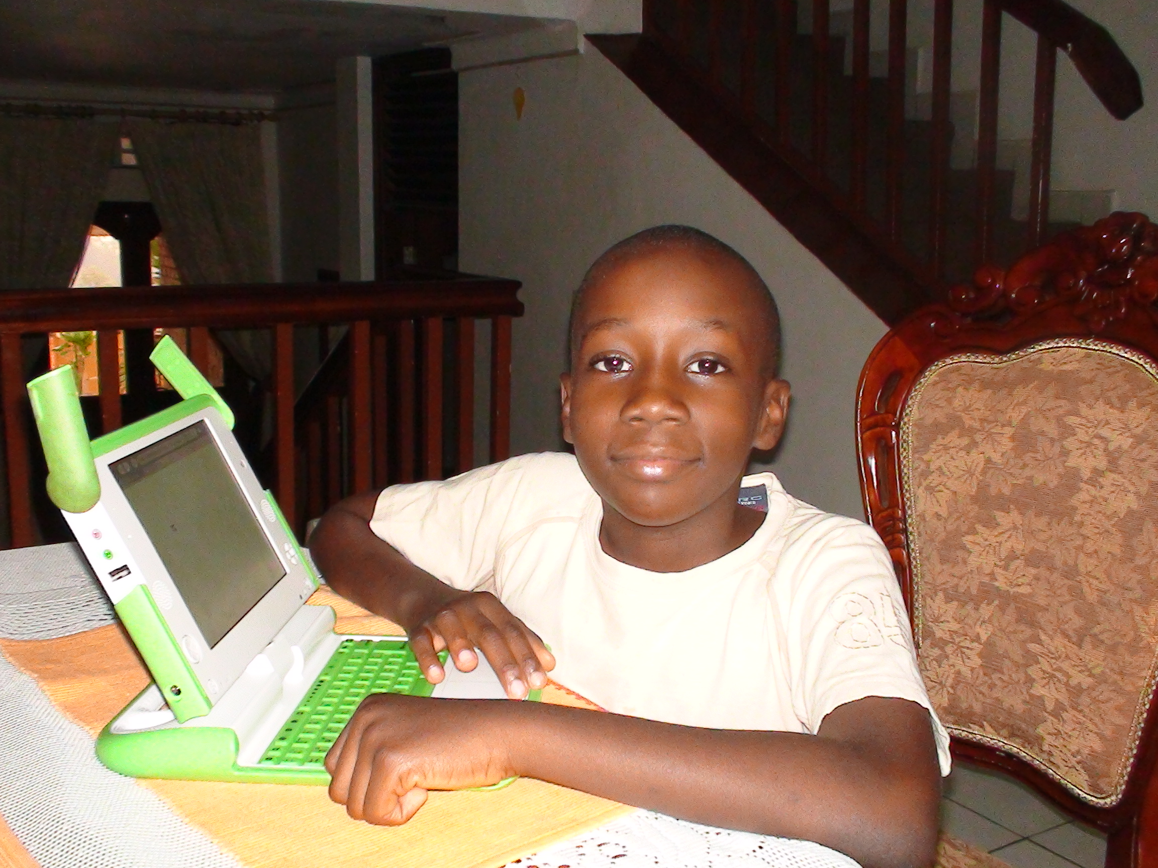 Collin Kabagambe with his laptop