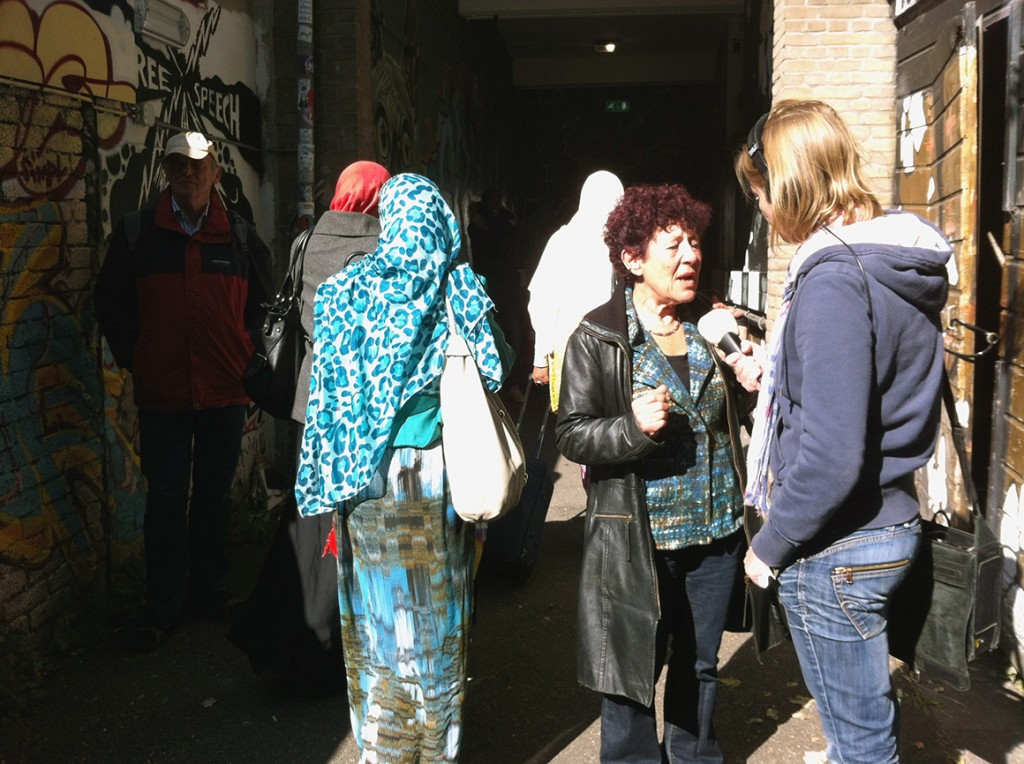 One of the Dutch volunteers talking to a journalist while the refugees were moving from cultural centre OT301 (Overtoom 301, Amsterdam) to De Bron (Hugo de Vrieslaan 2, Amsterdam), a church in Watergraafsmeer where they coud spend the night of 1 Oct. 2013.