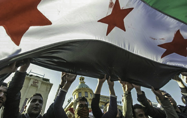 Syrian protesters wielding the revolution flag (Photo: flickr.com/photos/syriafreedom2)