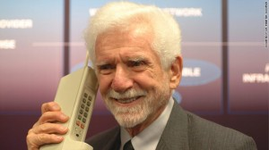 Martin Cooper with the first commercial cell phone, released in 1983.